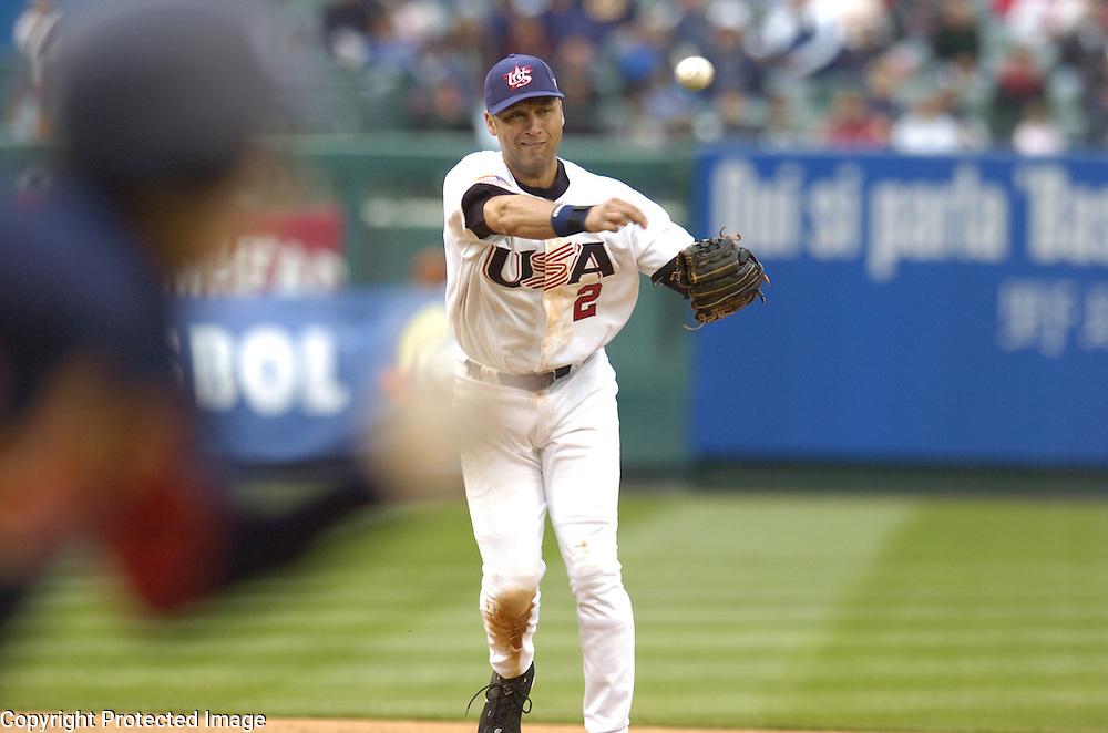 Team USA's Derek Jeter throws out Team Japan's Munenori Kawasaki in the 9th inning in Round 2 action at Angel Stadium of Anaheim.