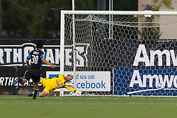 July 20, 2011; Santa Clara, CA, USA;  San Jose Earthquakes goalkeeper Jon Busch (18) is unable to stop a goal by Vancouver Whitecaps forward Eric Hassli (not pictured) during the first half at Buck Shaw Stadium.