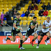 Beauden Barrett runs with the ball during the Super Rugby union game between Hurricanes and Sunwolves, played at Westpac Stadium, Wellington, New Zealand on 27 April 2018.   Hurricanes won 43-15.