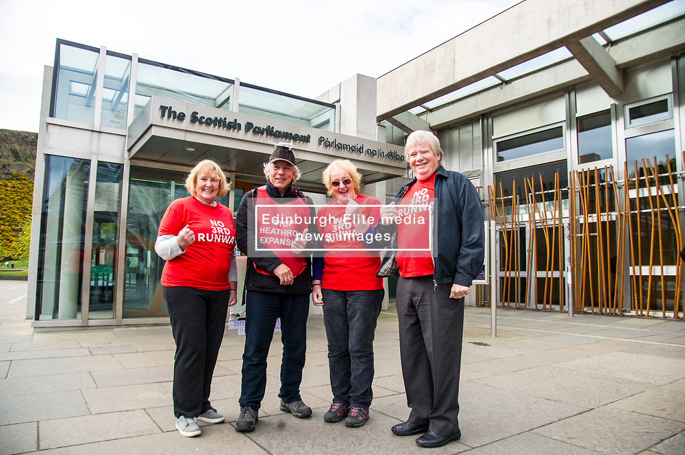 Pictured: Julia Ainsley,  Veronica Rumsey and Phil Rumsey from Richmond joined Neil Keveren outside the Scottish Parliament<br /> <br /> Anti-Heathrow third runway campaigner Neil Keveren, 50, arrives outside the Scottish Parliament after walking nearly 400 miles in protest at SNP backing for a third runway at the London airport. Neil walked on average 20 miles a day since 4 April with his support van givimg him a target to aim for each day.  Some of the residents on the flight path for the new runway have been there for over 40 years and many for all of their lives.  Flights arrive every three minutes between 4 and 5 am with the frequency increasing to every 90 seconds after 5am.<br /> Ger Harley   EEm 27 April 2017
