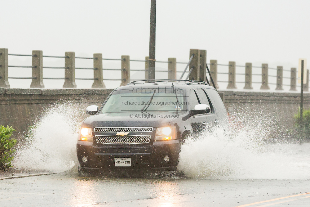 A car plows through floodwater along the Battery in the historic district as Hurricane Joaquin brings heavy rain, flooding and strong winds as it passes offshore October 3, 2015 in Charleston, South Carolina.