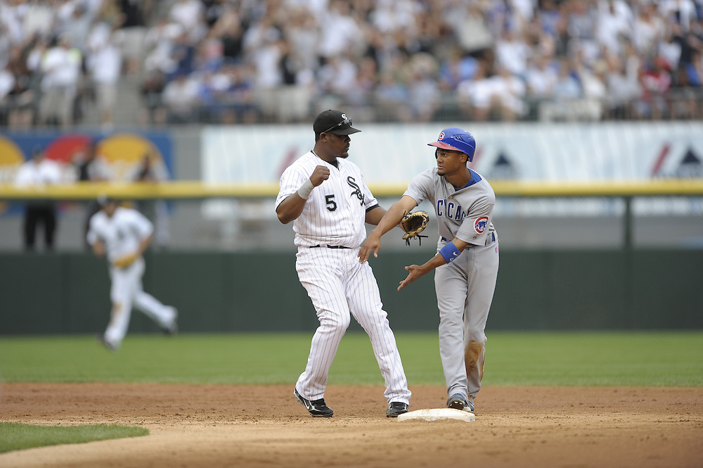 CHICAGO - JUNE 27:  Juan Uribe #5 of the Chicago White Sox turns a double play over a sliding Eric Patterson during the game against the Chicago Cubs at U.S. Cellular Field in Chicago, Illinois on June 27, 2008.  The White Sox defeated the Cubs 10-3.  (Photo by Ron Vesely)