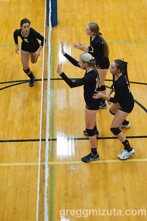 Preslee Jensen, Hannah Mizuta, Drew Dobney at the Kuna Klassic volleyball tournament at Kuna High School, Kuna, Idaho, August 29, 2015.