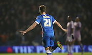 Brighton striker (on loan from Manchester United), James Wilson (21) scores to make it 1-0 to Brighton and celebrates during the Sky Bet Championship match between Brighton and Hove Albion and Reading at the American Express Community Stadium, Brighton and Hove, England on 15 March 2016.