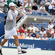 Andy Roddick of the US hits a forehand during his first round match on August 28, 2006, day one of the 2006 US Open Tennis Championships in Flushing Meadows, New York.