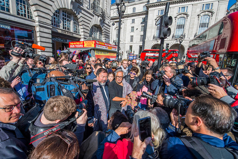 Both in Piccadilly Circus  in a media scrummage - Anish Kapoor and Ai Weiwei go for a walk in London - The two artists have joined hands to walk out of London on Thursday. Each will carry a single blanket as a symbol of the need that faces 60 million refugees in the world today. The Artists have said that they welcome Londoners to join them along their route and ask that Londoners too bring a blanket in gesture of support. The artists will repeat this action in cities across the world over the next few months. The walk started at 10am on Thursday 17th September, at the Royal Academy of Arts passed: Piccadilly Circus; Trafalgar Square; Whitehall;  St Paul's Cathedral; Bank and ended up at Stratford.