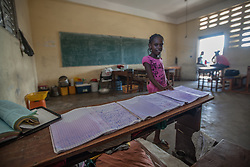 October 7, 2016 - Les Cayes, Haiti - A girl lays her school notebooks to dry in a classroom that she is staying in with her family, in Les Cayes, Haiti, on October 7, 2016. The school in Les Cayes is being used as shelter and is overly populated. Hurricane Matthew killed almost 900 people and displaced tens of thousands in Haiti before plowing northward on Saturday just off the southeast U.S. coast, where it caused major flooding and widespread power outages. (Credit Image: © Bahare Khodabande/NurPhoto via ZUMA Press)