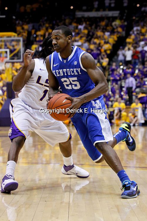 January 28, 2012; Baton Rouge, LA; Kentucky Wildcats guard Marquis Teague (25) drives past LSU Tigers guard Anthony Hickey (1) during the first half of a game at the Pete Maravich Assembly Center.  Mandatory Credit: Derick E. Hingle-US PRESSWIRE