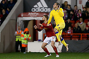 Leeds United forward Chris Wood  climbs with Nottingham Forest defender Matthew Mills  during the Sky Bet Championship match between Nottingham Forest and Leeds United at the City Ground, Nottingham, England on 27 December 2015. Photo by Simon Davies.