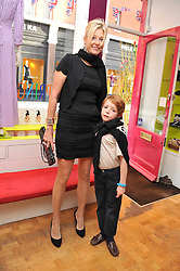 NADJA SWAROVSKI and her son RIGBY ADAMS at a party to celebrate the paperback launch of Detmar Blow's book 'Blow by Blow' held at Selina Blow, 1 Ellis Street, London SW1 on 21st June 2011.