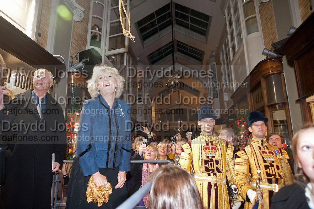 MAUREEN SUTHERLAND SMITH; SIR NICHOLAS GRIMSHAW; THE DUCHESS OF CORNWALL, When the Duchess  tugged the tassel it came off in her hand and the rope bounced above her head as she  Turned On The Christmas Lights At Burlington Arcade. Piccadilly. LONDON, 19 November 2009