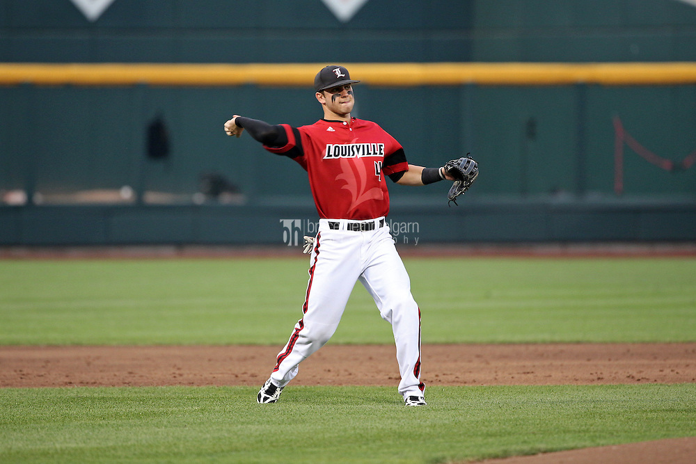 Alex Chittenden #4 of the Louisville Cardinals throws during Game 2 of the 2014 Men's College World Series between the Vanderbilt Commodores and Louisville Cardinals at TD Ameritrade Park on June 14, 2014 in Omaha, Nebraska. (Brace Hemmelgarn)