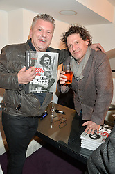Left to right, MARK FULLER and MARCO PIERRE WHITE at a private view to celebrate the 25th anniversary of the publication of White Heat featuring the photographs by Bob Carlos Clarke of Marco Pierre White held at the Little Black Gallery, 13 A Park Walk, London on 10th February 2015.