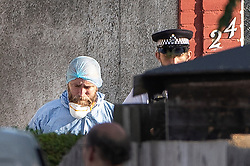 © Licensed to London News Pictures. 12/07/2019. London, UK. A police forensic scenes of crime investigator is seen outside an address in Redfern Avenue, Whitton, South West London where a man and a woman have been fatally stabbed. A 31-year-old man was arrested after a man, aged in his 60s, and a woman, aged in her 70s were found at the property with stab injuries. Photo credit: Peter Macdiarmid/LNP