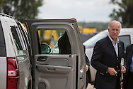 Vice President Joe Biden stands outside his SUV after arriving for a two-day campaign trip to Iowa on Monday, September 17, 2012 in Moline, IL.
