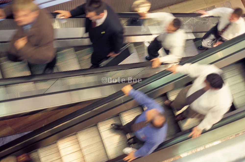 Business people going up and down on a escalator