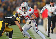 November 20 2010: Ohio State Buckeyes wide receiver Dane Sanzenbacher (12) prepares to be hit by Iowa Hawkeyes cornerback Micah Hyde (18) during the second quarter of the NCAA football game between the Ohio State Buckeyes and the Iowa Hawkeyes at Kinnick Stadium in Iowa City, Iowa on Saturday November 20, 2010. Ohio State defeated Iowa 20-17.