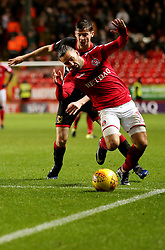Charlton Athletics Ricky Holmes (front) and Milton Keynes Dons Conor McGrandles during the Sky Bet League One match at The Valley, Charlton.