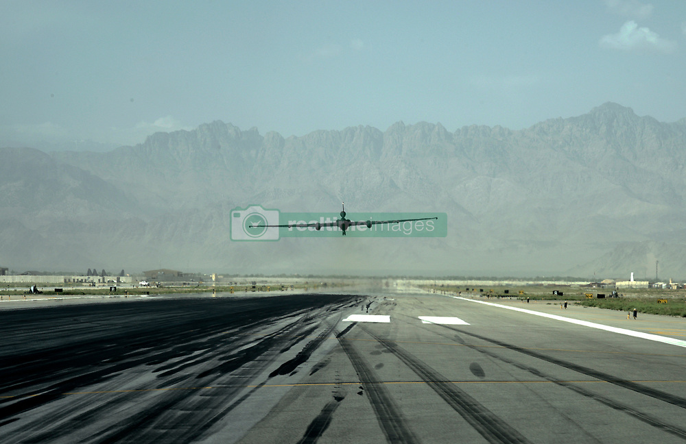 A U-2 Dragon Lady, 380th Air Expeditionary Wing, Al Dhafra Air Base, United Arab Emirates, takes off from Bagram Airfield, Afghanistan, June 22, 2018.  Mobile chase car drivers act as a second pair of eyes and ears for U-2 pilots during their launch and landings, making up for the pilot's limited movement and vision.  Once an aircraft nears the runway, chase cars speed off in pursuit close behind it, radioing adjustments to pilot until they are inches from the ground. (U.S. Air Force photo by Staff Sgt. Kristin High)