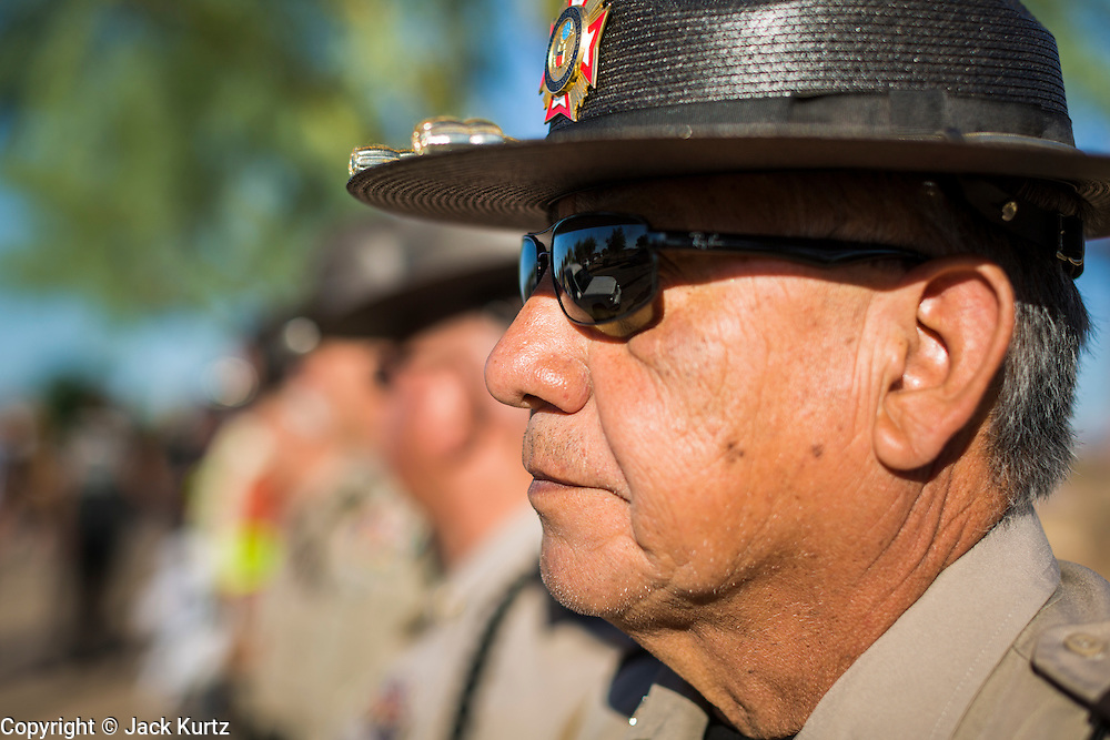 08 OCTOBER 2013 - PHOENIX, AZ: A member of Veterans Of Foreign Wars honor guard waits to receive an urn containing the cremated remains of a US military veteran. The cremated remains of 36 unclaimed US military veterans were interred at the National Memorial Cemetery in Phoenix. Members of the US military and several hundred veterans of the US military attended the service, which was a part of the Missing In America Project (MIAP).      PHOTO BY JACK KURTZ