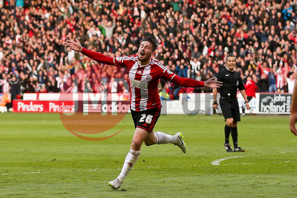 Kieron Freeman of Sheffield United celebrates after scoring the opening goal to make it 1-0 - Photo mandatory by-line: Matt McNulty/JMP - Mobile: 07966 386802 - 07/05/2015 - SPORT - Football - Sheffield - Bramall Lane - Sheffield United v Swindon Town - Sky Bet League One