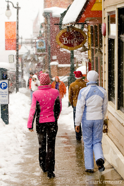 snowy afternoon with many people on Main Street, Park City, Utah