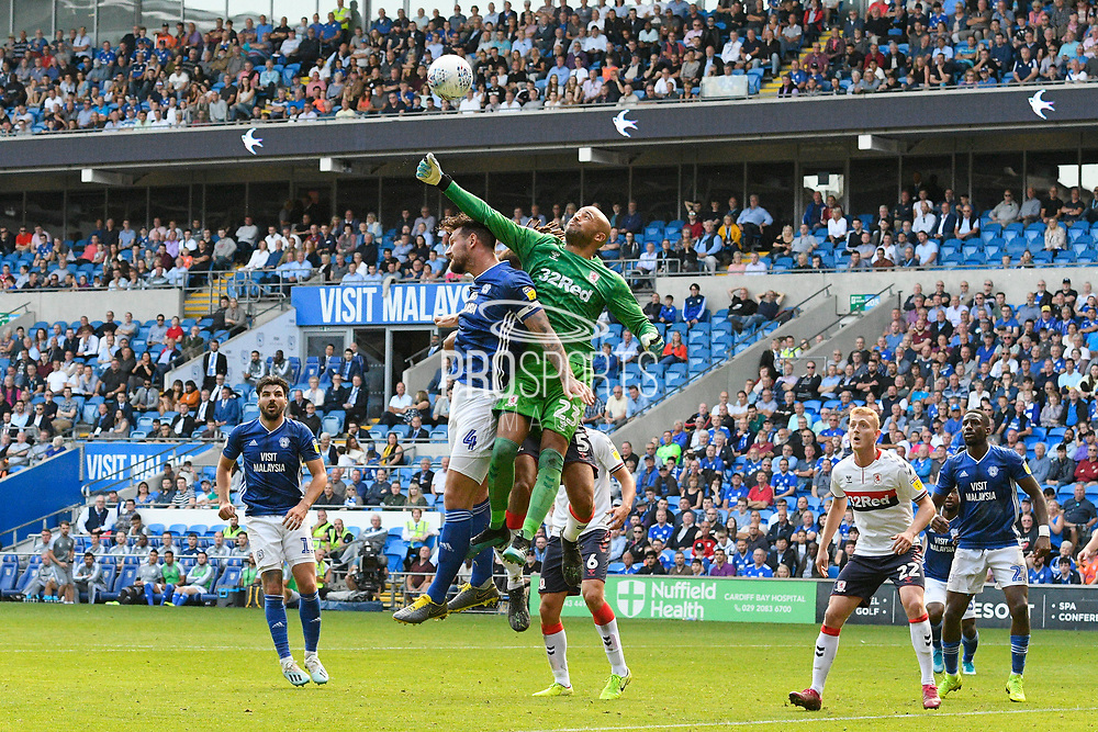 Darren Randolph (23) of Middlesbrough jumps above Sean Morrison (4) of Cardiff City to tip the ball out of danger during the EFL Sky Bet Championship match between Cardiff City and Middlesbrough at the Cardiff City Stadium, Cardiff, Wales on 21 September 2019.