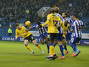Chris McCann opens the scoring with a header during the Sky Bet Championship match between Sheffield Wednesday and Wigan Athletic at Hillsborough, Sheffield, England on 29 November 2014.