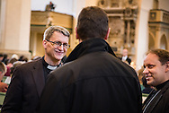 The Rev. Tony Booker, LCMS regional director for Eurasia, greets colleagues at the Town and Parish Church of St. Mary's before the dedication of The International Lutheran Center at the Old Latin School on Sunday, May 3, 2015, in Wittenberg, Germany. LCMS Communications/Erik M. Lunsford