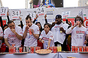 Competitive eater Joey Chestnut works his way through his 34th slice of pizza in the Famous Famiglia world championship pizza eating contest in New York City's Times Square. (Joey Chestnut is included in the book What I Eat: Around the World in 80 Diets.) He won the $5,000 first prize after eating 45 slices of cheese pizza in 10 minutes.  Each slice weighed 109 grams (3.84 ounces) and contained 260 calories. In ten minutes Joey consumed 10.81 pounds (4.9 kilograms) of pizza and drank a gallon of water. The pizza contained 11,700 calories