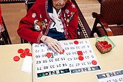 Elva McKittrick turned 110 in December, 2010. She is photographed playing bingo in Royal Oaks, a community within Sun City. Elva is Sun City's oldest resident, though there are more than a dozen residents who live in Royal Oaks that are 100 or older. ..2010 marks the 50th anniversary of Sun City, America's first retirement city that remains the largest today with more than 40,000 residents 55 and older.