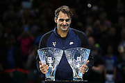 Roger Federer picks up the fans favourite and Stefan Edberg during the Barclays ATP World Tour Finals at the O2 Arena, London, United Kingdom on 15 November 2015. Photo by Phil Duncan.