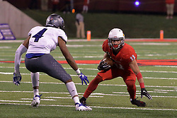 NORMAL, IL - September 08: Spencer Schnell looks for a way past Raymond Crittenden during 107th Mid-America Classic college football game between the ISU (Illinois State University) Redbirds and the Eastern Illinois Panthers on September 08 2018 at Hancock Stadium in Normal, IL. (Photo by Alan Look)