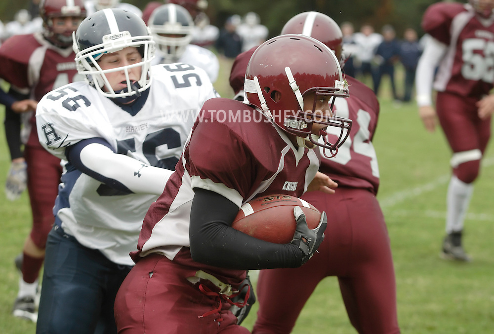 Cornwall-on-Hudson, New York - A New York Military Academy running back carries the football during a high school football game against the Harvey School on Oct. 17, 2009.