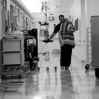 Nick walks down the hallway with Kiersa in his arms at  Doernbecher Children's Hospital in Portland, Ore.
