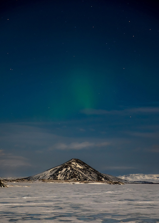 MÝVATN, ICELAND - CIRCA MARCH 2015: Aurora Borealis, also known as Northern Lights over Mývatn during winter time. This is a popular tourist destination in Iceland.