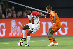 (L-R), Andre Carrillo of Peru, Memphis Depay of Holland during the International friendly match match between The Netherlands and Peru at the Johan Cruijff Arena on September 06, 2018 in Amsterdam, The Netherlands