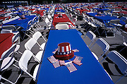 American flags and party hats on tables flanked by folding chairs