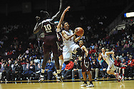 "Mississippi Lady Rebels guard A'Queen Hayes (3) vs. Mississippi State Lady Bulldogs center Martha Alwal (10) and Mississippi State Lady Bulldogs guard Dominique Dillingham (00) at the C.M. ""Tad"" Smith Coliseum in Oxford, Miss. on Thursday, January 22, 2015. (AP Photo/Oxford Eagle, Bruce Newman)"