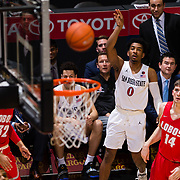 15 January 2019: San Diego State Aztecs guard Devin Watson (0) hits three point shot as the Aztecs go on a run in the second half. The Aztecs beat to the New Mexico Lobos 97-77 Tuesday night at Viejas Arena.