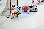 McQuaid forward Brennan Brown tries and fails to get the puck past Pittsford goalie William Hernes during the annual Pink the Rink game at RIT's Gene Polisseni Center in Henrietta on Saturday, February 4, 2017.