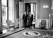 On a state visit to Dublin, French President Francois Mitterand paid a visit to Áras an Uachtaráin, where he was greeted by Irish President Patrick Hillery. Here President Hillery leads President Mitterand into the drawing room at the Áras.<br />