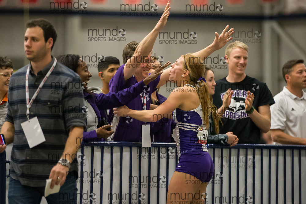 Windsor, Ontario ---2015-03-13--- Caroline Ehrhardt of Western University celebrates a new personal best in the long jump with her coach Frank Erle at the 2015 CIS Track and Field Championships in Windsor, Ontario, March 13, 2015.<br /> GEOFF ROBINS/ Mundo Sport Images