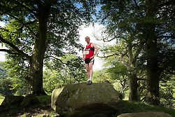 © Licensed to London News Pictures . 30/07/2015 . Ambleside , UK . TIM FARRON , newly elected leader of the Liberal Democrat Party in the UK and MP for Westmorland and Lonsdale , poses on a rocky outcrop after running in a fell race in the Lake District National Park . Photo credit: Joel Goodman/LNP