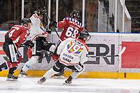2019-12-01 | Umeå, Sweden:Kiruna (12) Samuel Ivanic battles for the puck with Teg (68) Marcus Eklund in  HockeyEttan during the game  between Teg and Kiruna at A3 Arena ( Photo by: Michael Lundström | Swe Press Photo )<br /> <br /> Keywords: Umeå, Hockey, HockeyEttan, A3 Arena, Teg, Kiruna, mltk19120