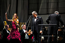 ANAHEIM, CA - JUN 9: Italian tenor Andre Bocelli performed Granada, New York, La Boheme, LaTraviata among others keeping audience mesmerized at the Honda Center in Anaheim, CA. The magical night included producer David Foster on Piano, Violinist Caroline Campbell, American Idol Season 3 winner Soul Singer Fantasia, Cuban Soprano Maria Aleida and Orchestra Conductor Eugene Kohn. Volinist Caroline Campbell (L) performs with Andrea Bocelli (C) and Conductor Eugene Kohn (R). All fees must be agreed prior to publication, Byline and/or web usage link must  read  PHOTO: SilvexPhoto.com