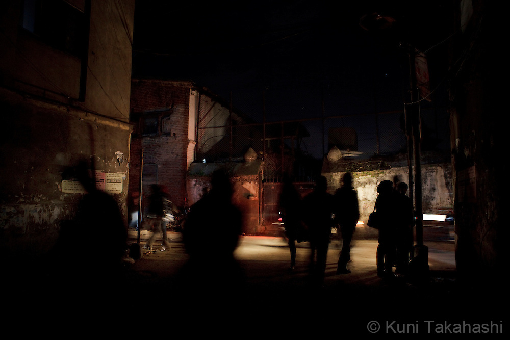 (Jan 3, 2012 - Kathmandu, Nepal).Streets are only illuminated by vehicle lights during power outage in Kathmandu, Nepal, on Jan 3, 2012. For the last several years, nearly 800,000 people of the capital city faced up to 16 hours of blackouts every day, mainly caused by political instability. Nepal is said to be second only to Brazil in terms of water resources but the government has been incapable of harnessing hydropower..(Photo by Kuni Takahashi)