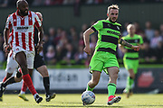 Forest Green Rovers Carl Winchester(7) passes the ball forward during the EFL Sky Bet League 2 match between Forest Green Rovers and Cheltenham Town at the New Lawn, Forest Green, United Kingdom on 20 October 2018.