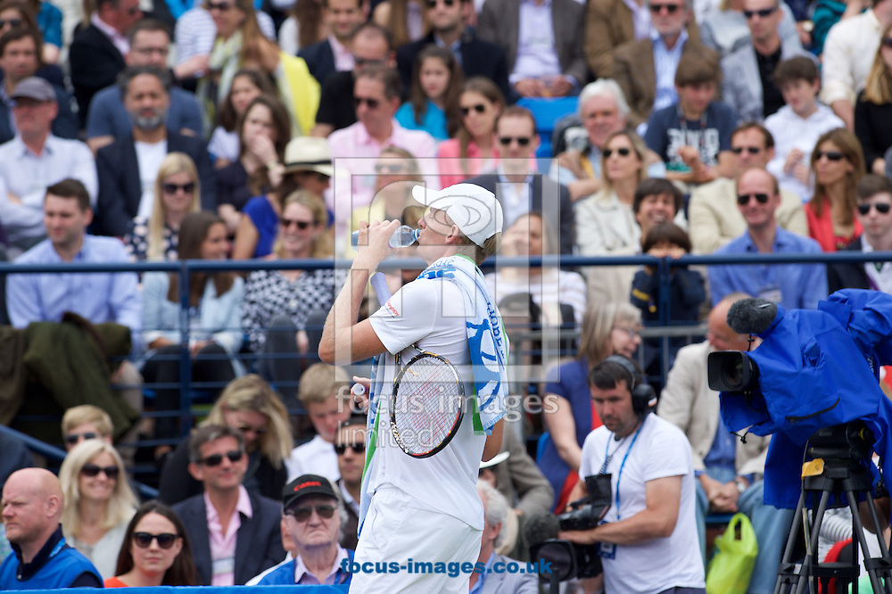 Kevin Anderson of South Africa takes a drink during his semi-final match against Giles Simon of France in Aegon Championships at the Queen's Club, West Kensington<br /> Picture by Alan Stanford/Focus Images Ltd +44 7915 056117<br /> 20/06/2015