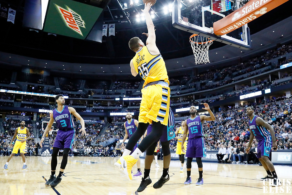 04 March 2017: Denver Nuggets forward Nikola Jokic (15) goes for the baby hook during the Charlotte Hornets 112-102 victory over the Denver Nuggets, at the Pepsi Center, Denver, Colorado, USA.